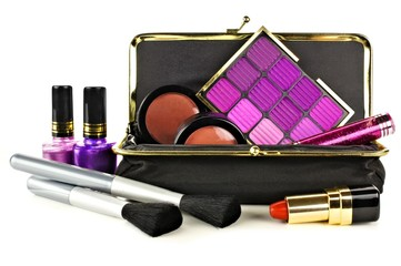 Makeup bag with assorted purple hue cosmetics on white