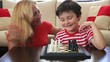 Mother  teaches son how to play chess