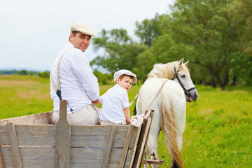 funny photo of farmer family and horse looking back