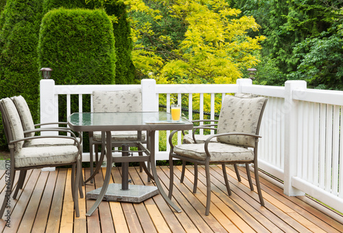 Outdoor Furniture on Cedar Wood Patio during nice day - 65741670