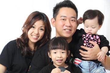 Asian Family portrait inside home