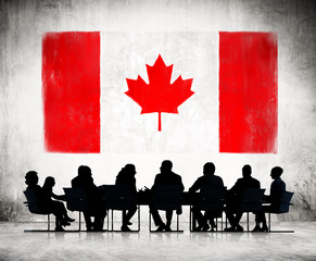 Business People and the National Flag of Canada