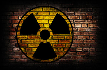 Radiation sign on a brick wall.