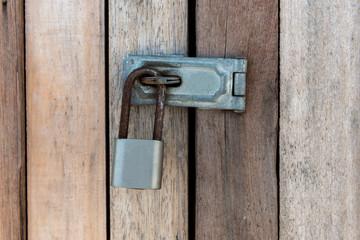Close up of padlock and old metal hasp