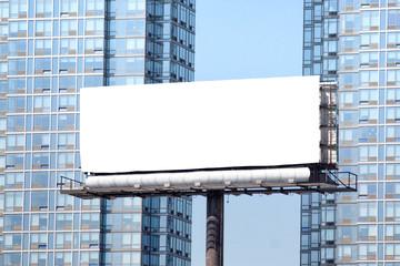 Big white billboard between towers.