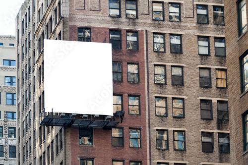 Big white billboard on the wall. - 65742857