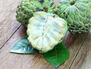 Custard apple fruit on the wood table.