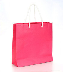 Pink shopping paper bag isolated on a white background