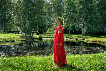 Beautiful young woman in russian tradition dress