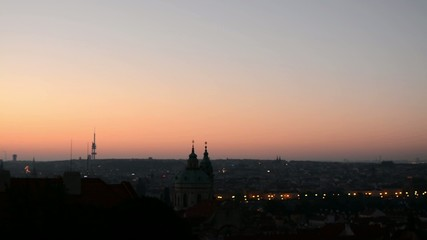 Sunrise over Prague - roofs of urban buildings