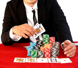 Young handsome man playing texas hold'em
