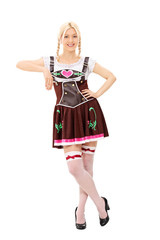 Bavarian woman leaning on an imaginary wall