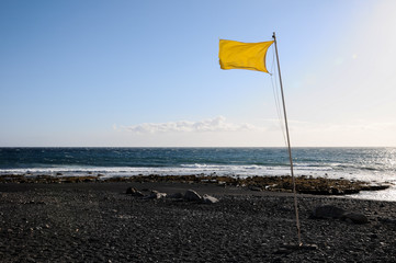 Yellow Festive Flag Waving In The Wind