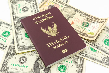Thailand passport on U.S. Currency bank note.