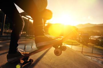 skateboarder  at sunrise skatepark