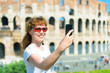 Selfie of a young female tourist near the Colosseum