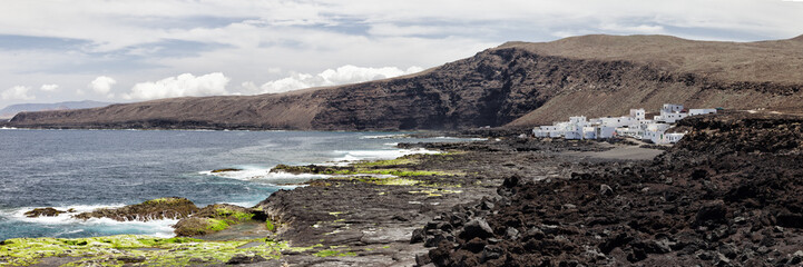 Lanzarote landscape.Village in the lava field.