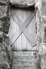 Old wooden door is closed it.