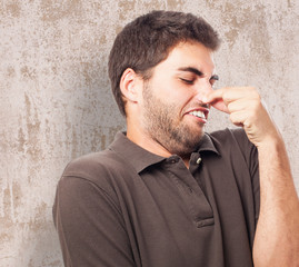 portrait of young man smelling closeup photo