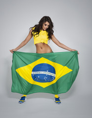 Gorgeous woman support of brazilian soccer team