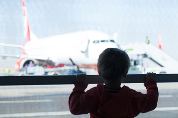 Little boy watching planes at the airport