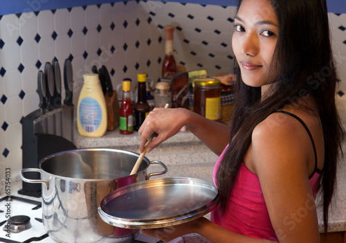 woman cooking on the cooker