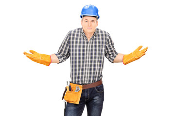 Confused male engineer gesturing with hands