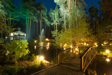 Cozy resort by the lake in the conifer forest at night