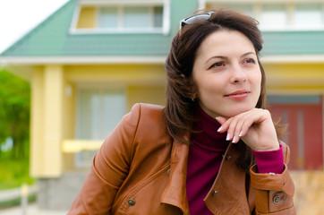 Beautiful young woman sitting daydreaming