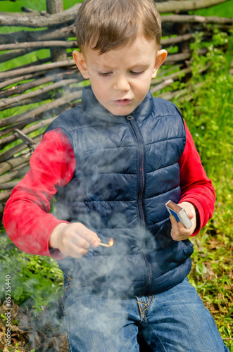 Child striking a match