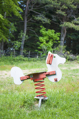 Rocking horse in the forest