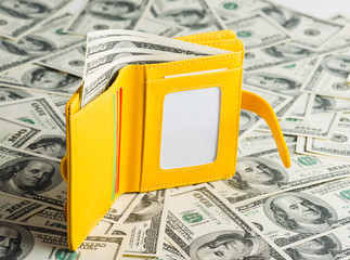 yellow Wallet Resting Upon Many United States One Hundred Dollar