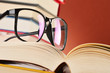 Composition with glasses and books on the table