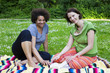 two women in park with a book