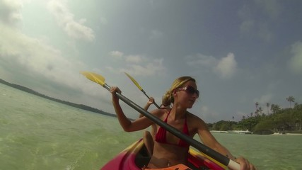 Young couple kayaking in tropical waters