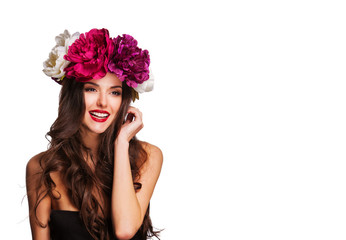 sexy woman with perfect hairstyle and bright flowers on her head