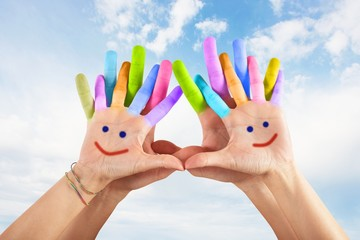 Painted hands with smile