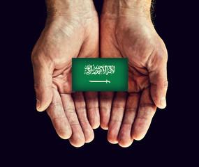 saudi arabia flag in hands