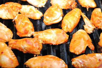 Many Spicy Chciken Wing Pieces Grilling