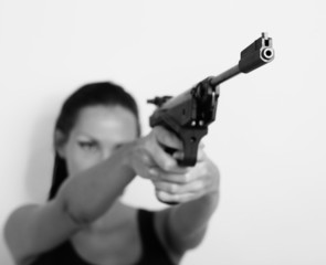 Woman with gun, self-defense (The carrying and use of weapons)