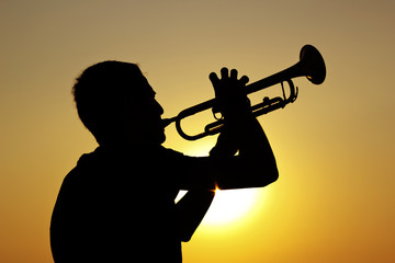 Silhouette of trumpet player