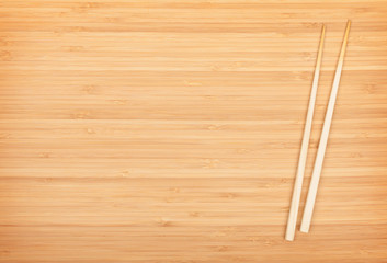 Sushi chopsticks on bamboo table