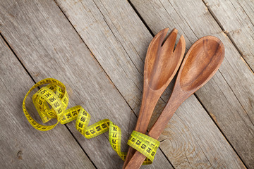 Measure tape with kitchen utensils. Diet food
