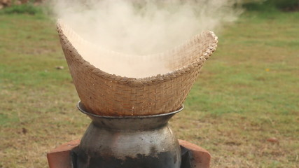 Stick rice boil steam in weaving bamboo and pot, HD Clip.