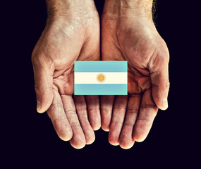 argentina flag in hands