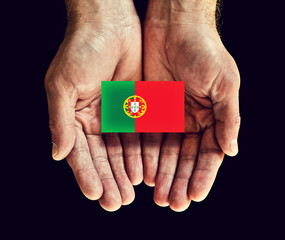 portugal flag in hands