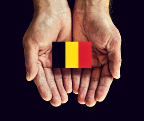 belgium flag in hands