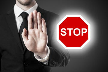 businessman holding hand block stop sign