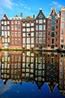Canal houses of Amsterdam with vibrant reflections