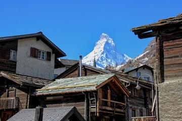 Matterhorn set behind wooden lodges
